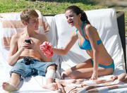 Selena Gomez - wearing a bikini by a pool and beach in Mexico 12/07/11 x10HQ *Lots of adds*
